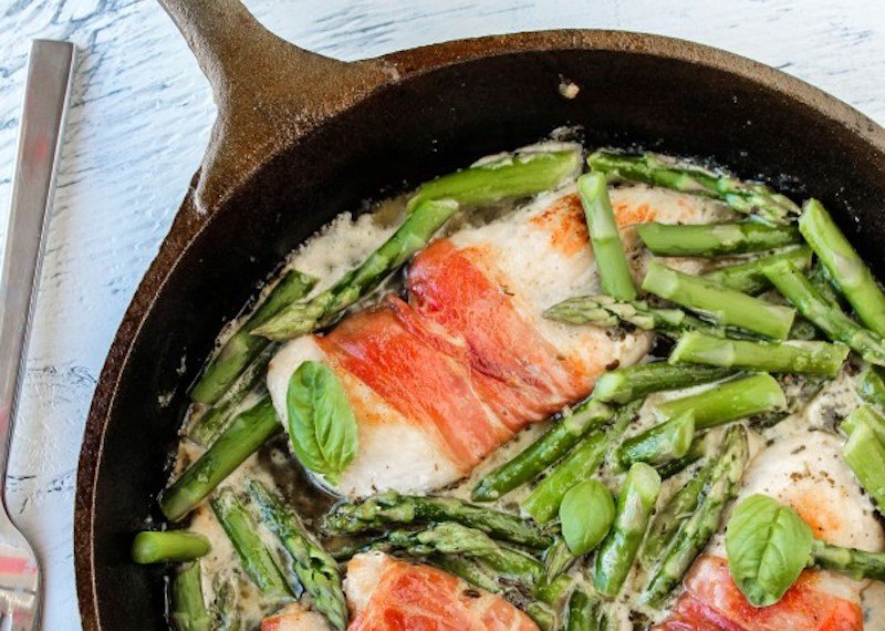 Prosciutto-Wrapped Chicken with Asparagus in cast iron