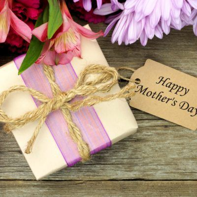 Mother's Day gift box and flowers on wood