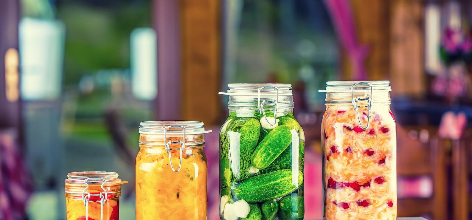 Canning. Preserving. Pickles jars. Jars with pickles, pumpkin dip, white cabbage.