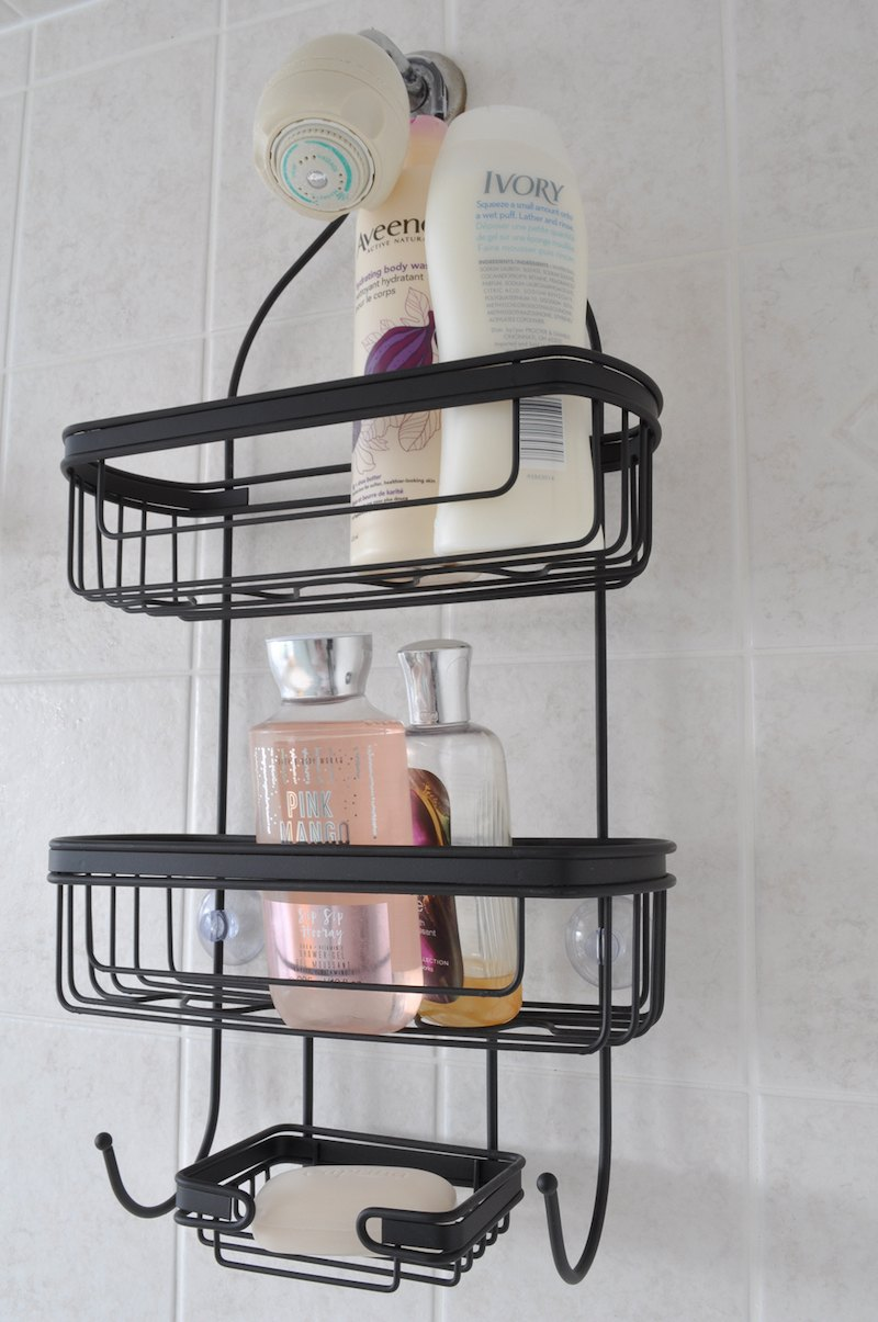 black shower caddy with bath products