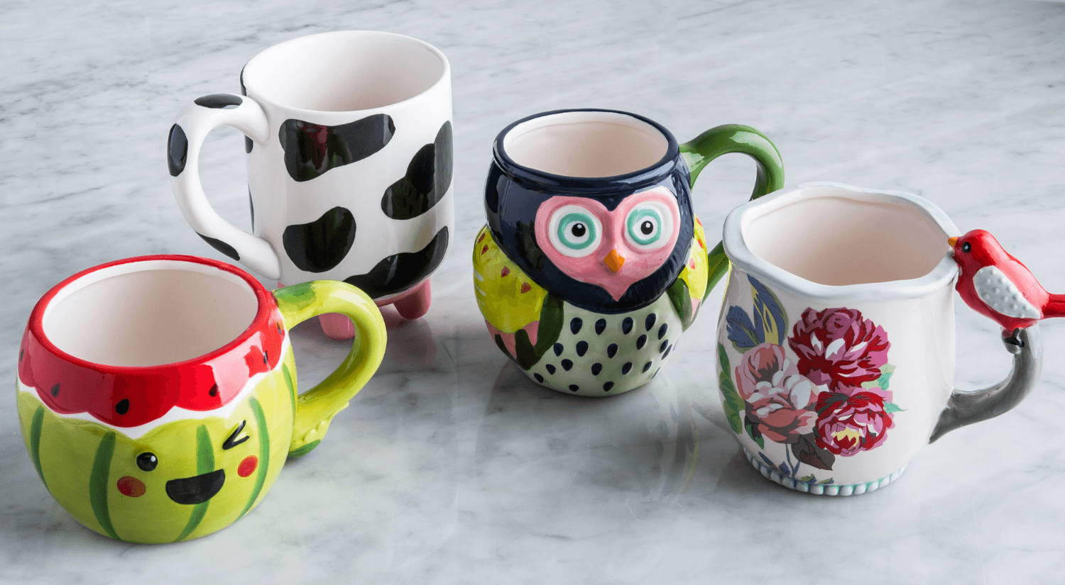 4 unique and colourful mugs with floral, cow, owl and watermelon designs