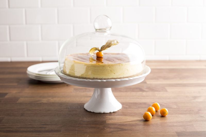 white porcelain cake plate with clear glass cover