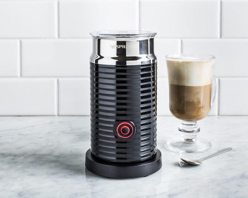 black nespresso milk frother beside a latte