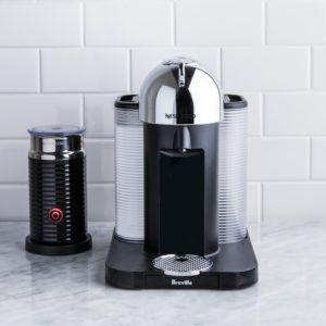 nespresso virtuoline espresso maker beside nespresso milk frother