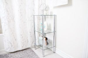 3 tiered glass shelves with bath products