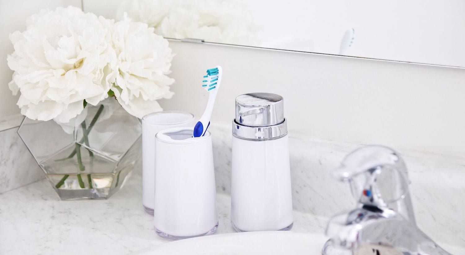 white acrylic soap pump, toothbrush holder, and tumbler