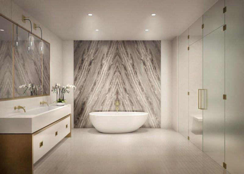 jake gyllenhaal's master bathroom with marble and, glass and gold hardware