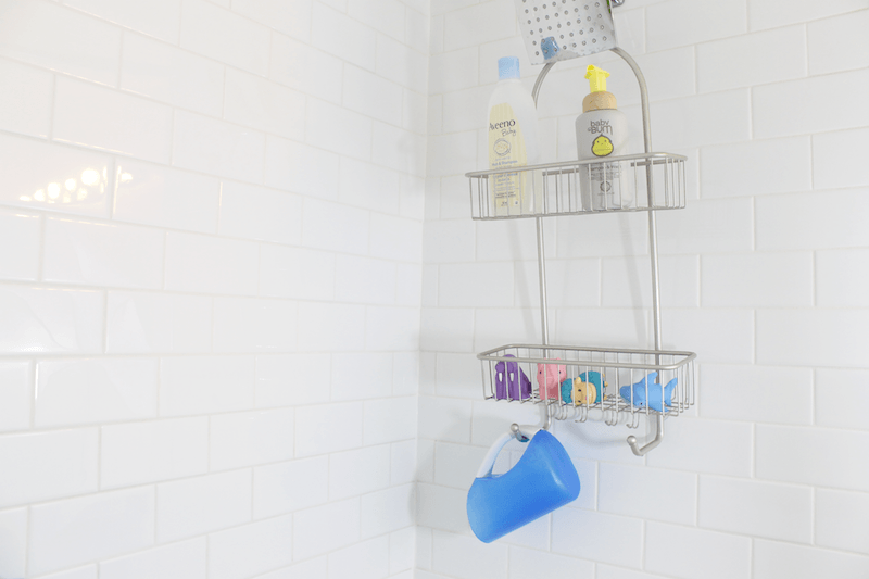chrome shower caddy filled with bath essentials