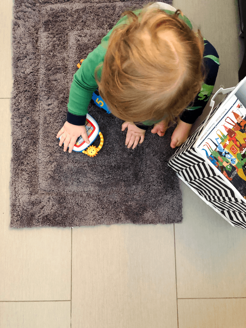 child sitting on a microfiber bath mat