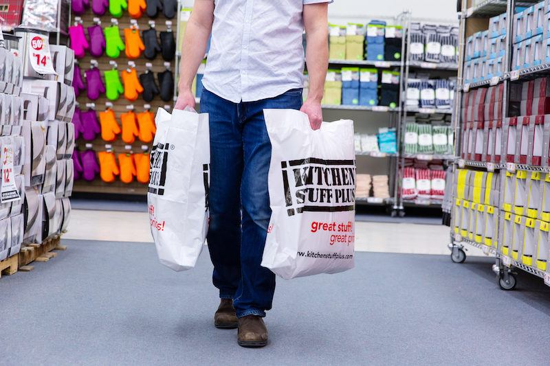 warehouse sale shopper holding bags