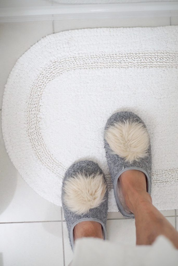 slippers on bathroom rug