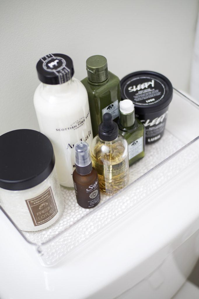 clear bin with skin care and bath products