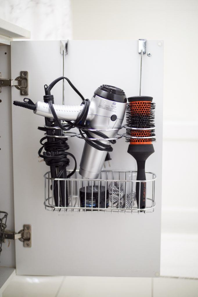 over the cabinet rack for hair products with curling iron brush hair dryer