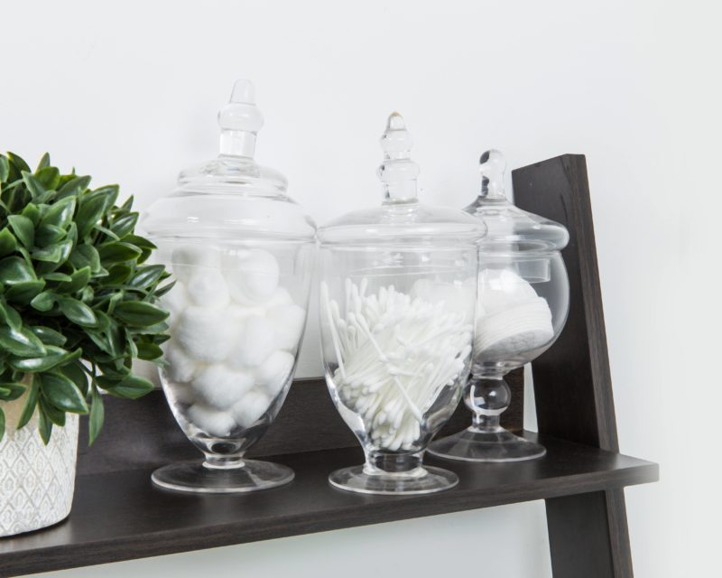 glass apothecary jars with cotton balls, q tips, and cotton pads