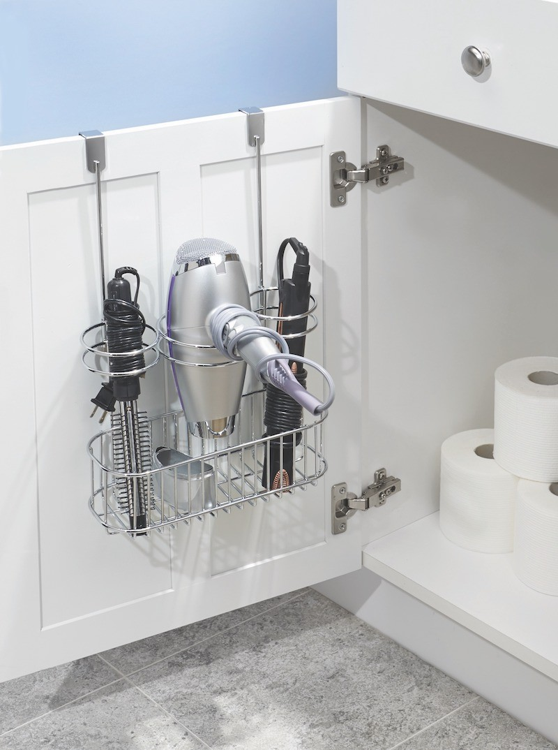 chrome over cabinet rack with a blow dryer and other hair tools stored securely