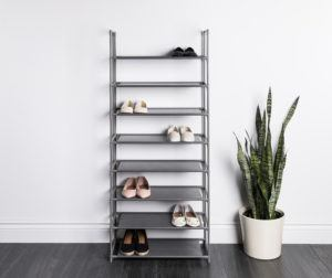 grey shoe rack with metal exterior and 8 fabric shelves.