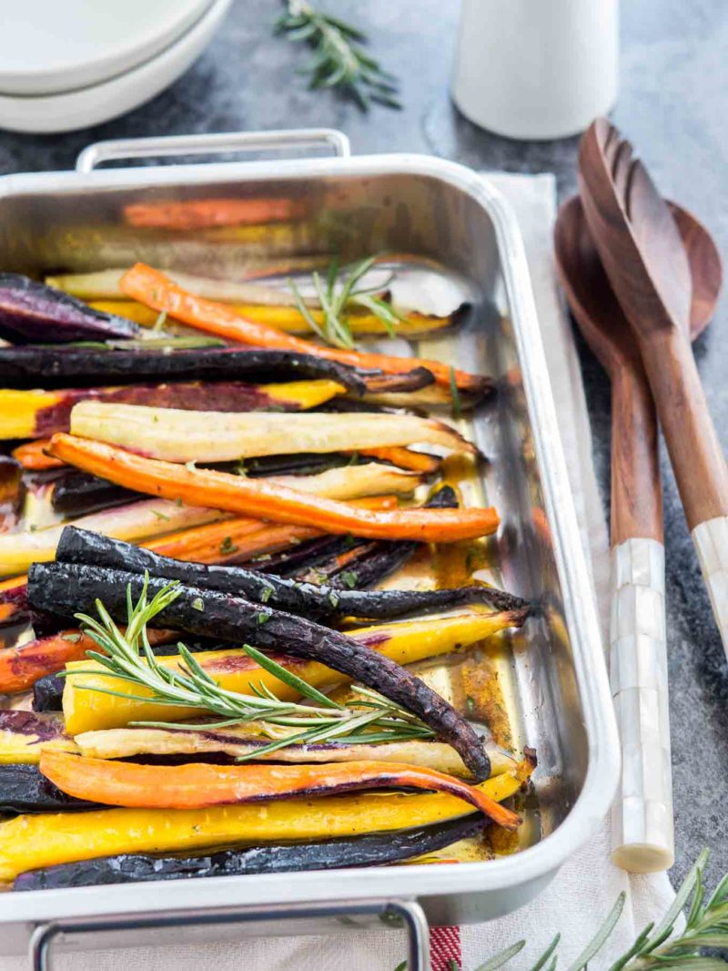 colourful carrots in a pan with rosemary