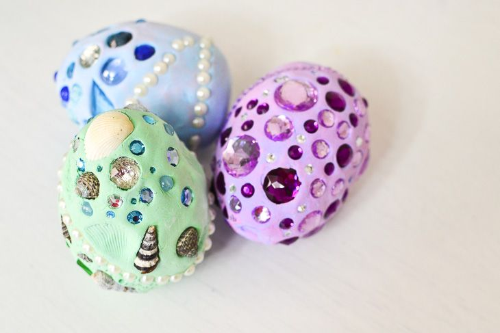 toy dragon eggs covered with beads and jewels