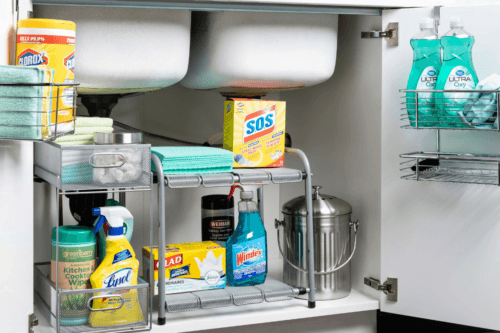 cleaning products organized under the sink