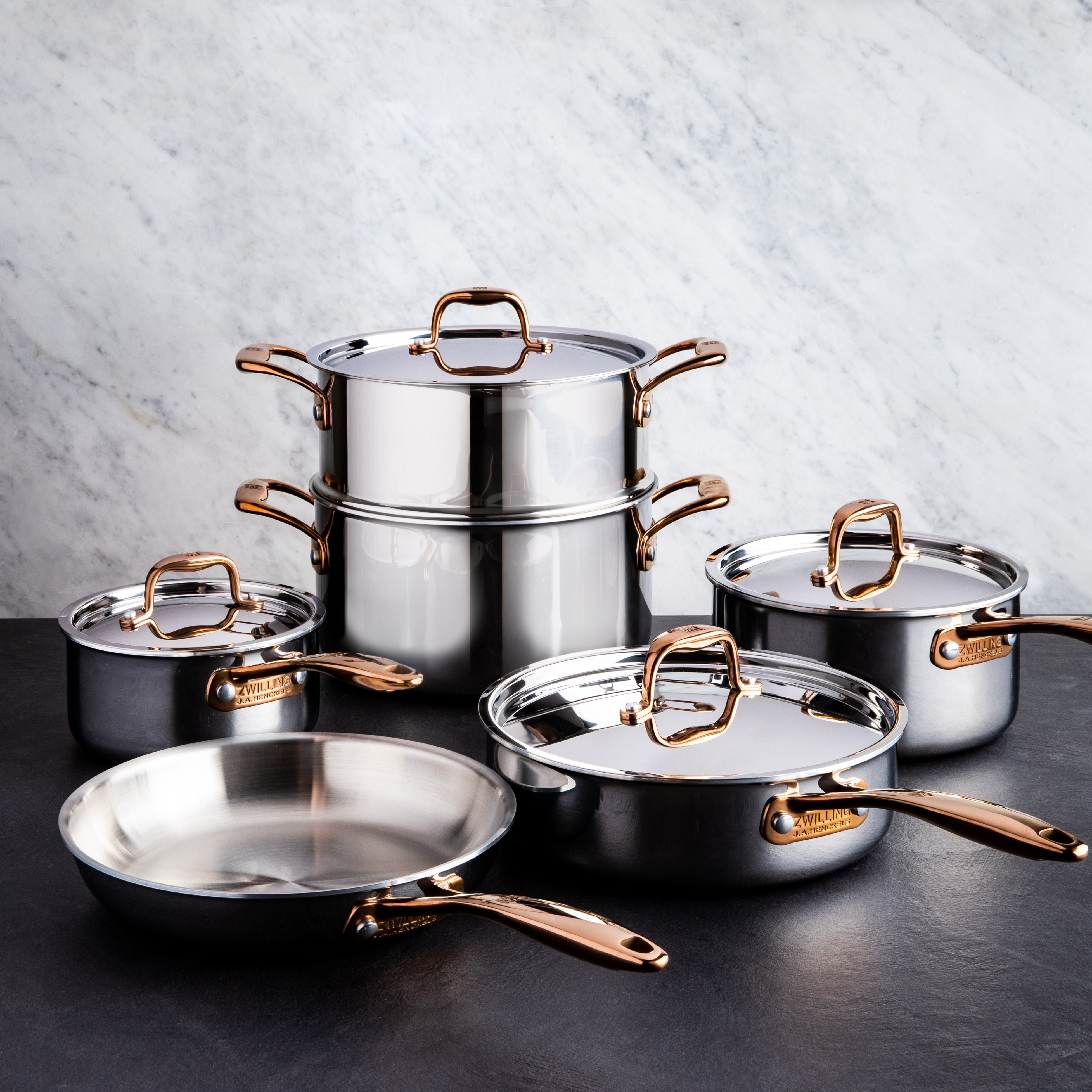 brushed stainless steel cookware set with rose gold accents