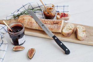 bread knife resting beside sliced bread