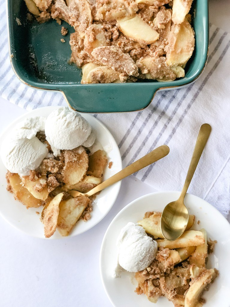 apple crisp topped with ice cream