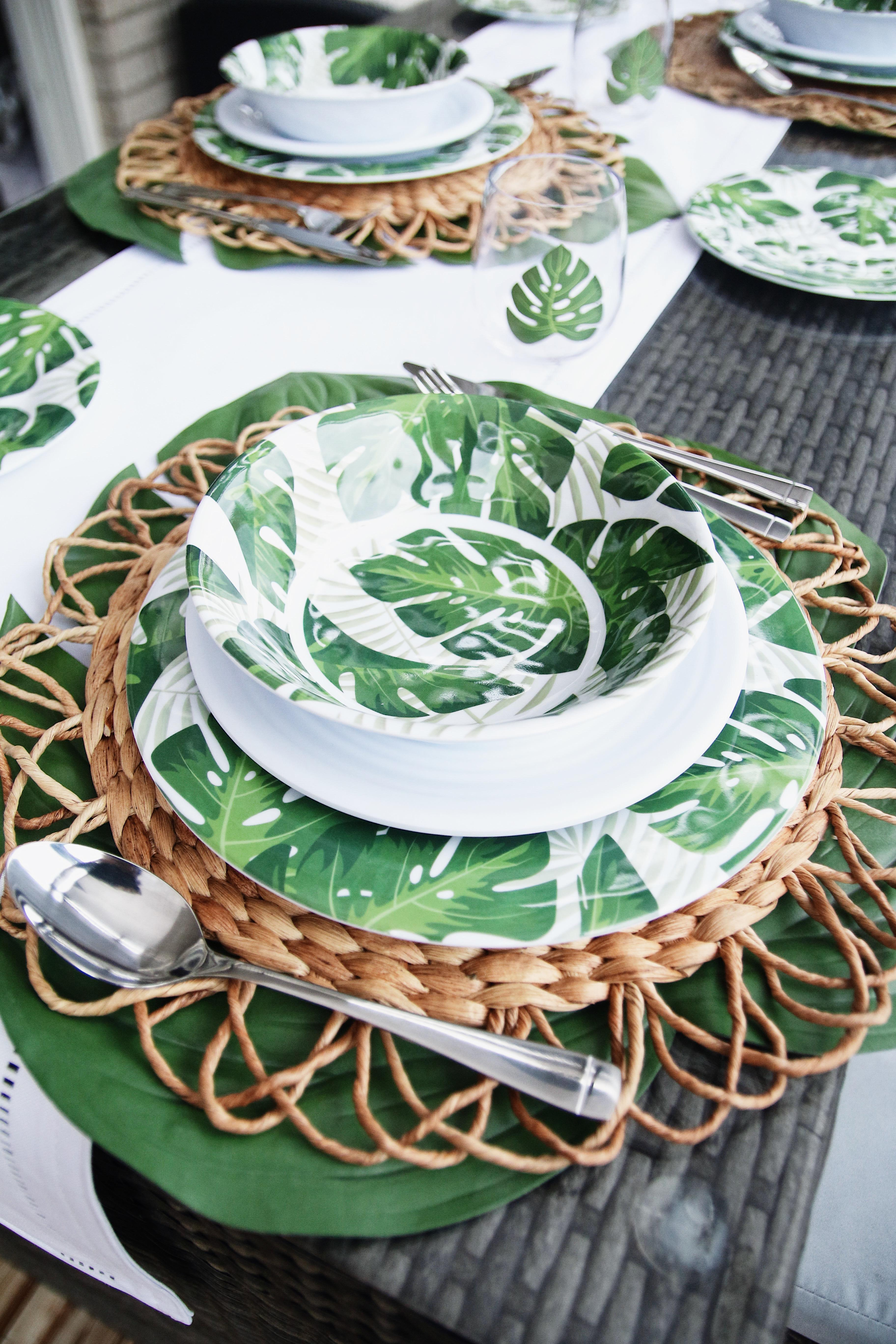 tablescape with leaf patterned dinnerware