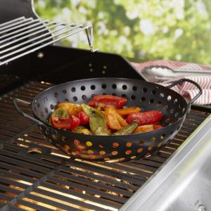 non-stick wok on a grill filled with peppers