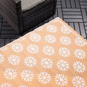 coral colour carpet with white flower pattern