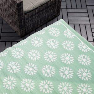 mint colour carpet with white flower pattern