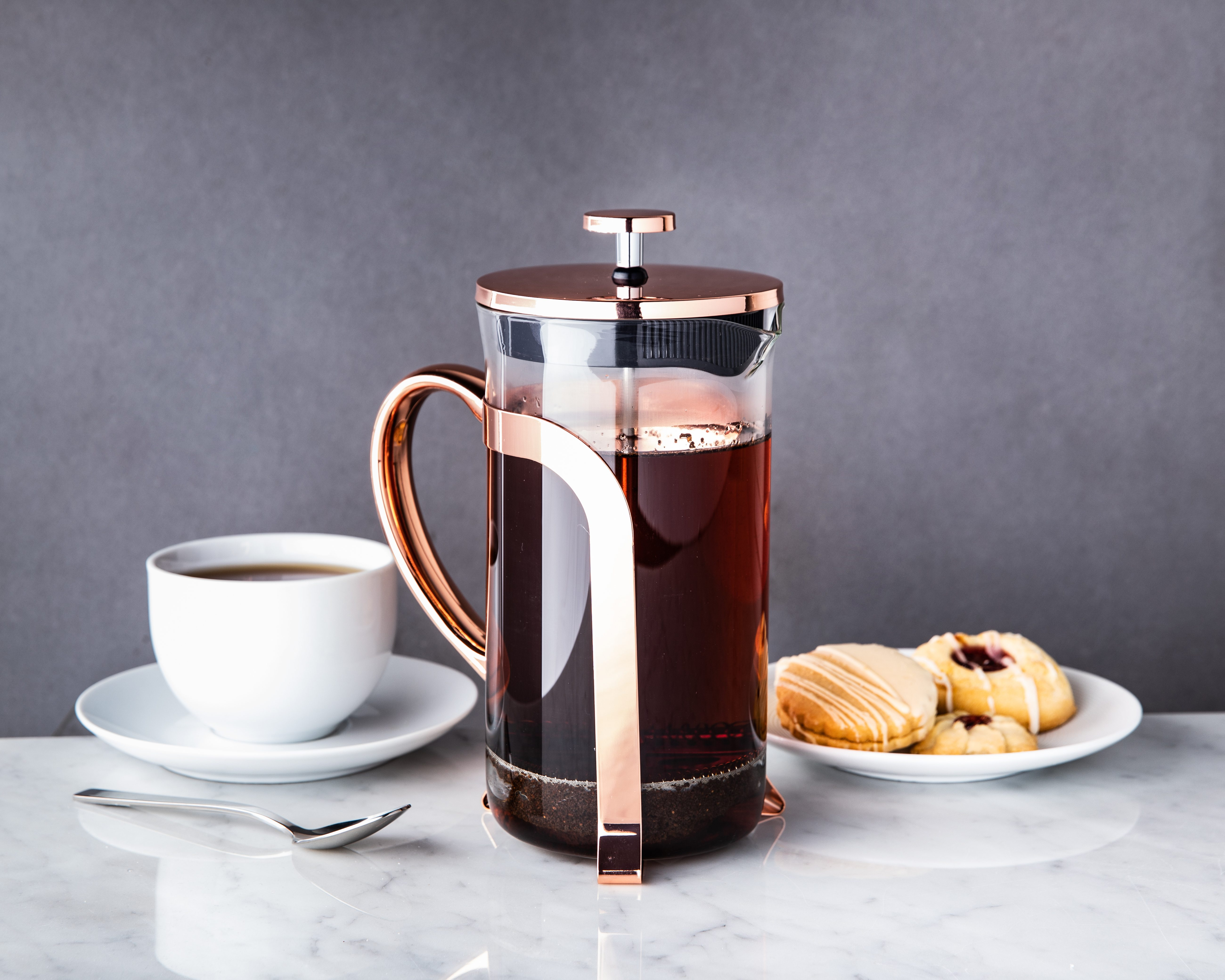 rose gold french coffee press full of coffee