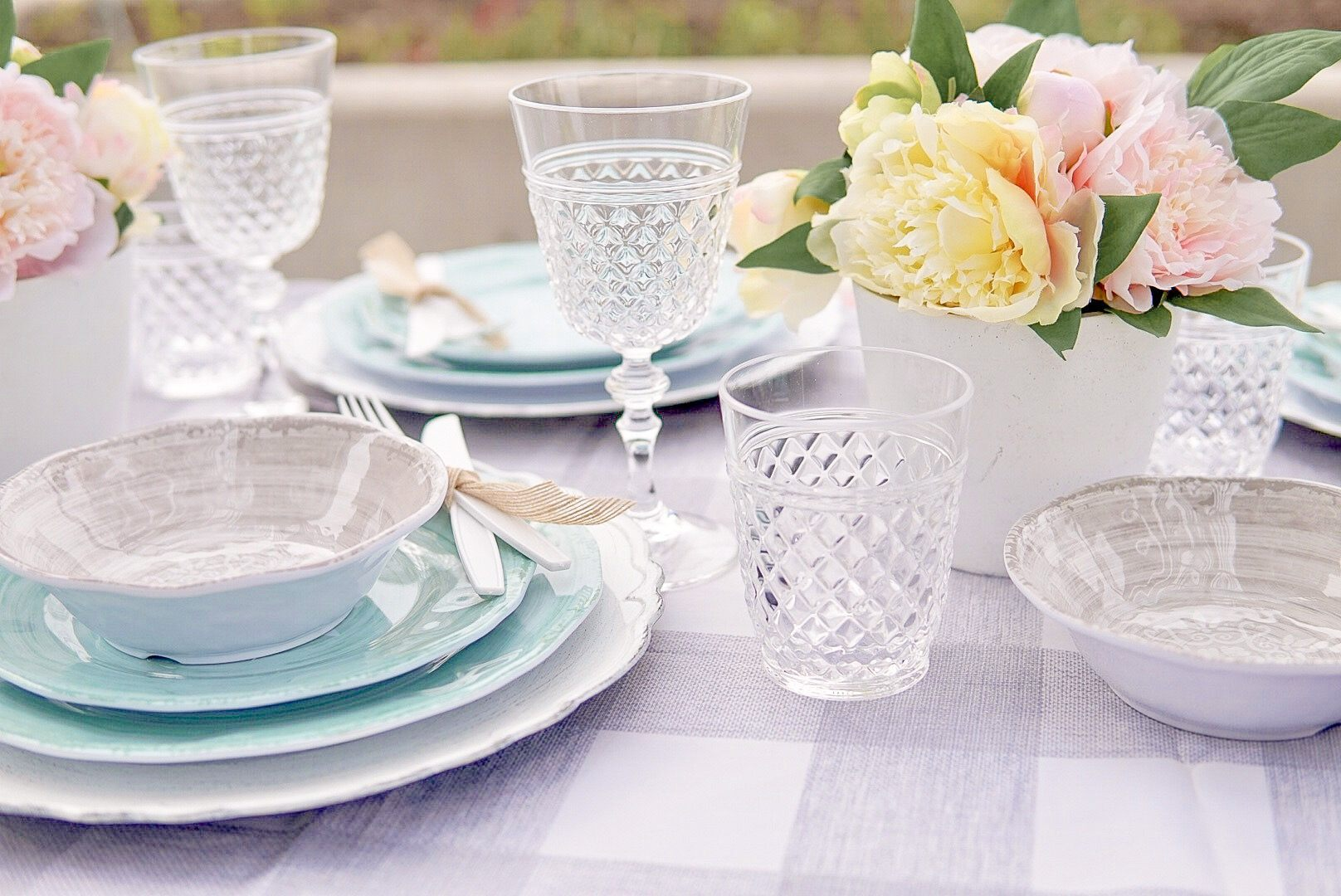 clear acrylic glasses on a tablescape
