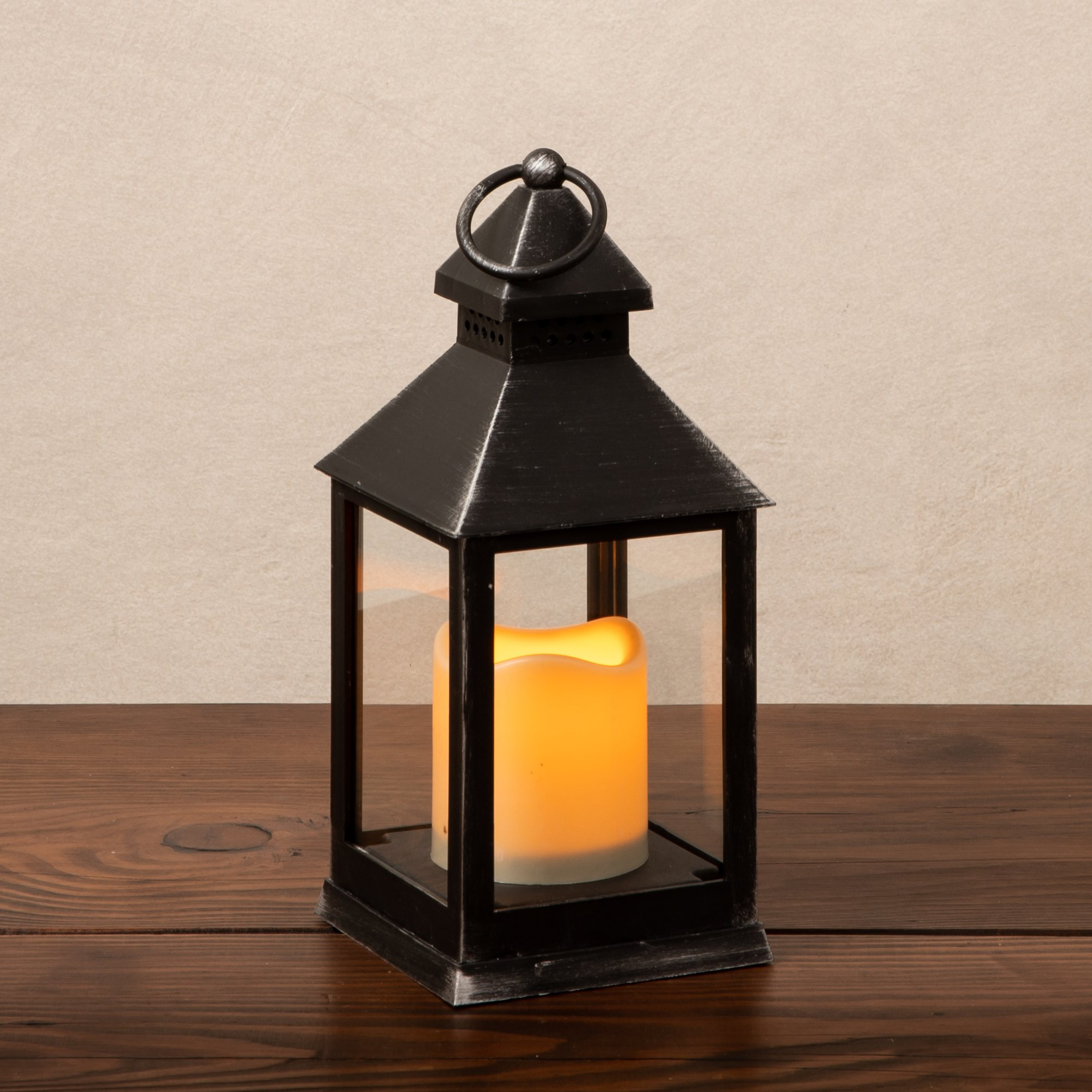 small black plastic lantern with an led candle
