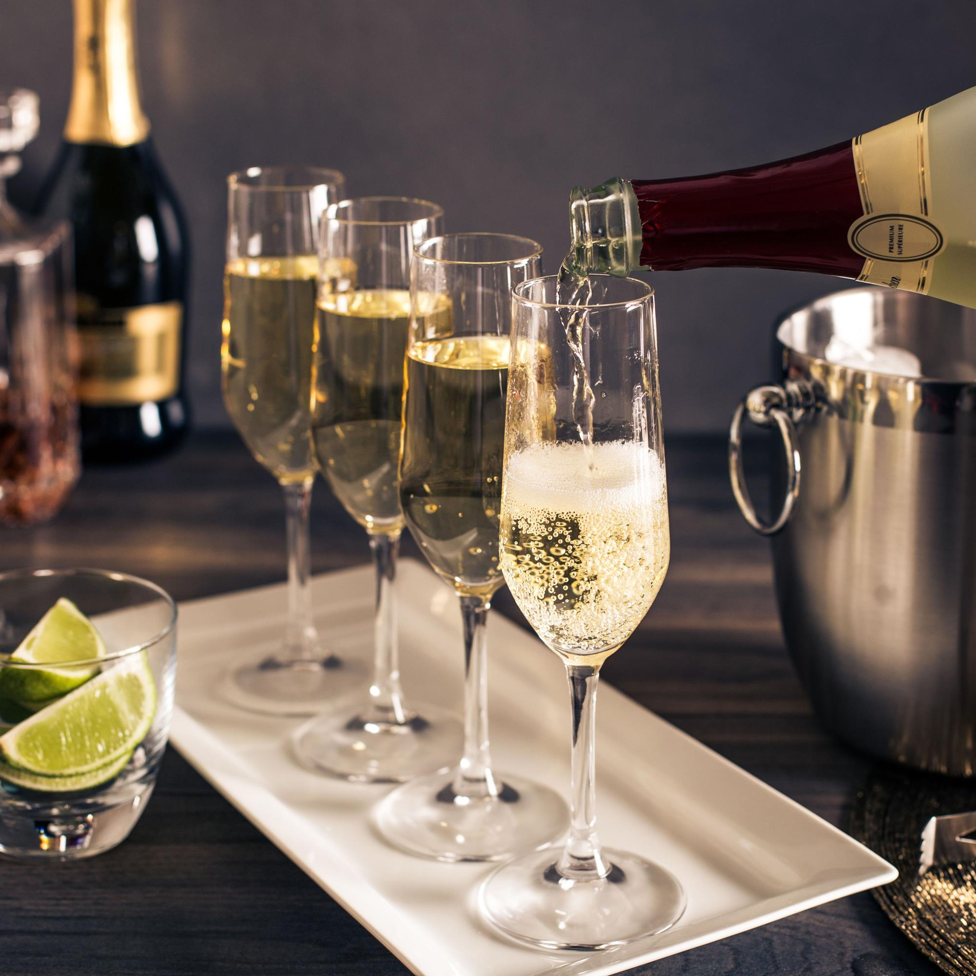 champagne flutes with champagne on a white platter wedding gifts