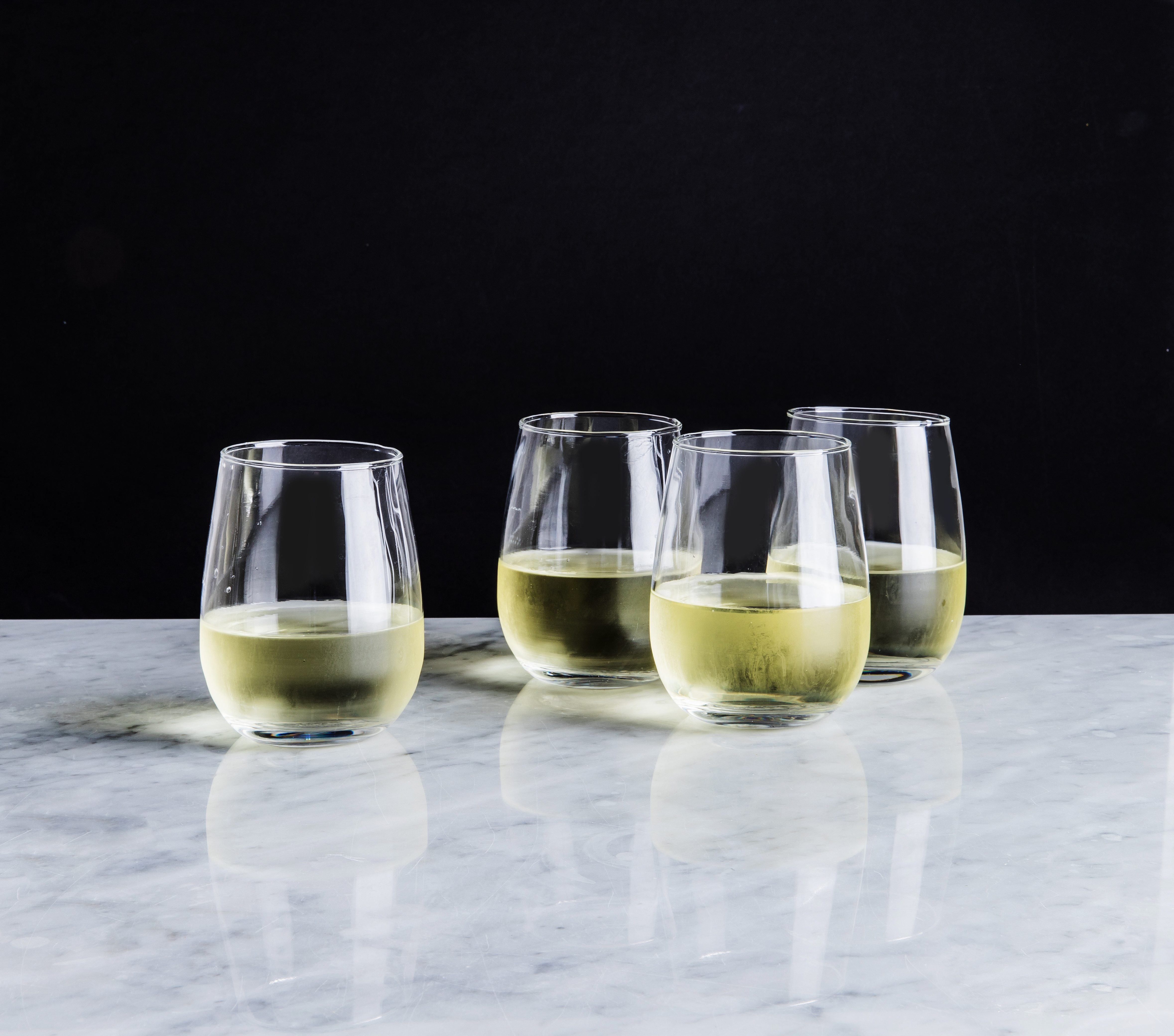 stemless wine glasses filled with white wine