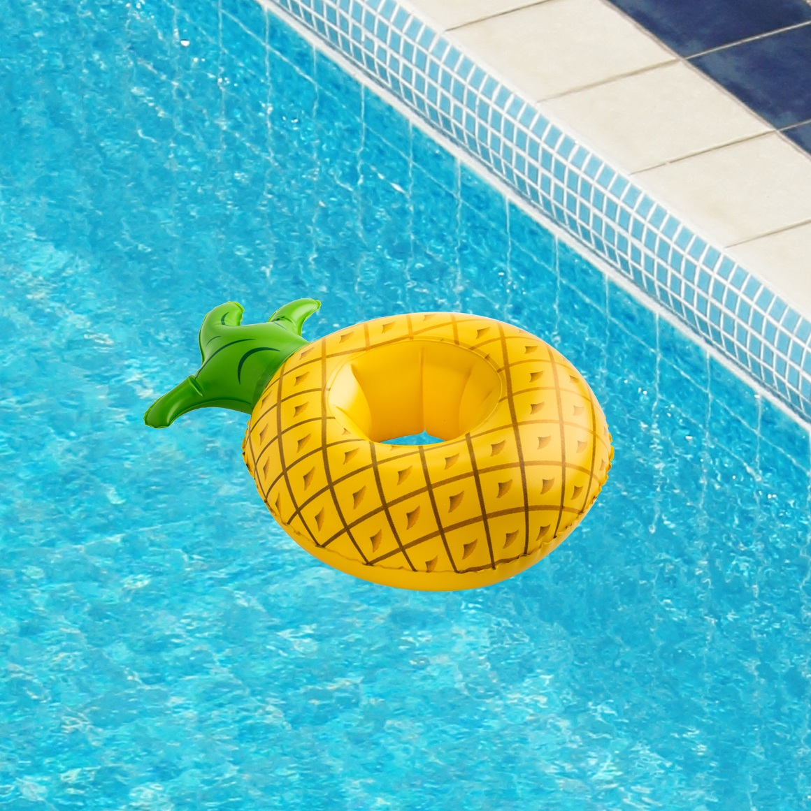pineapple drink floatie in a swimming pool