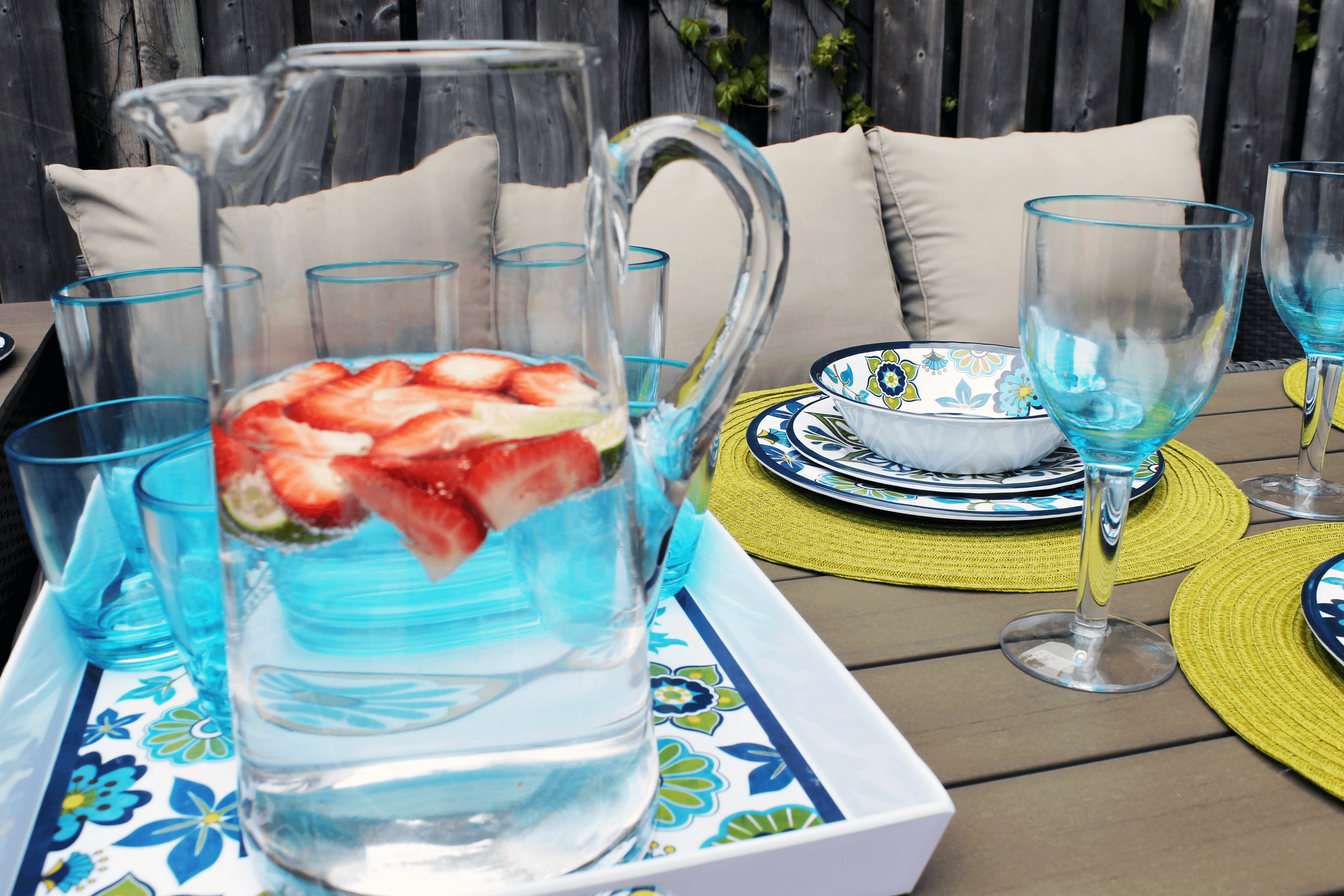 pitcher with sliced strawberries, lime, and water