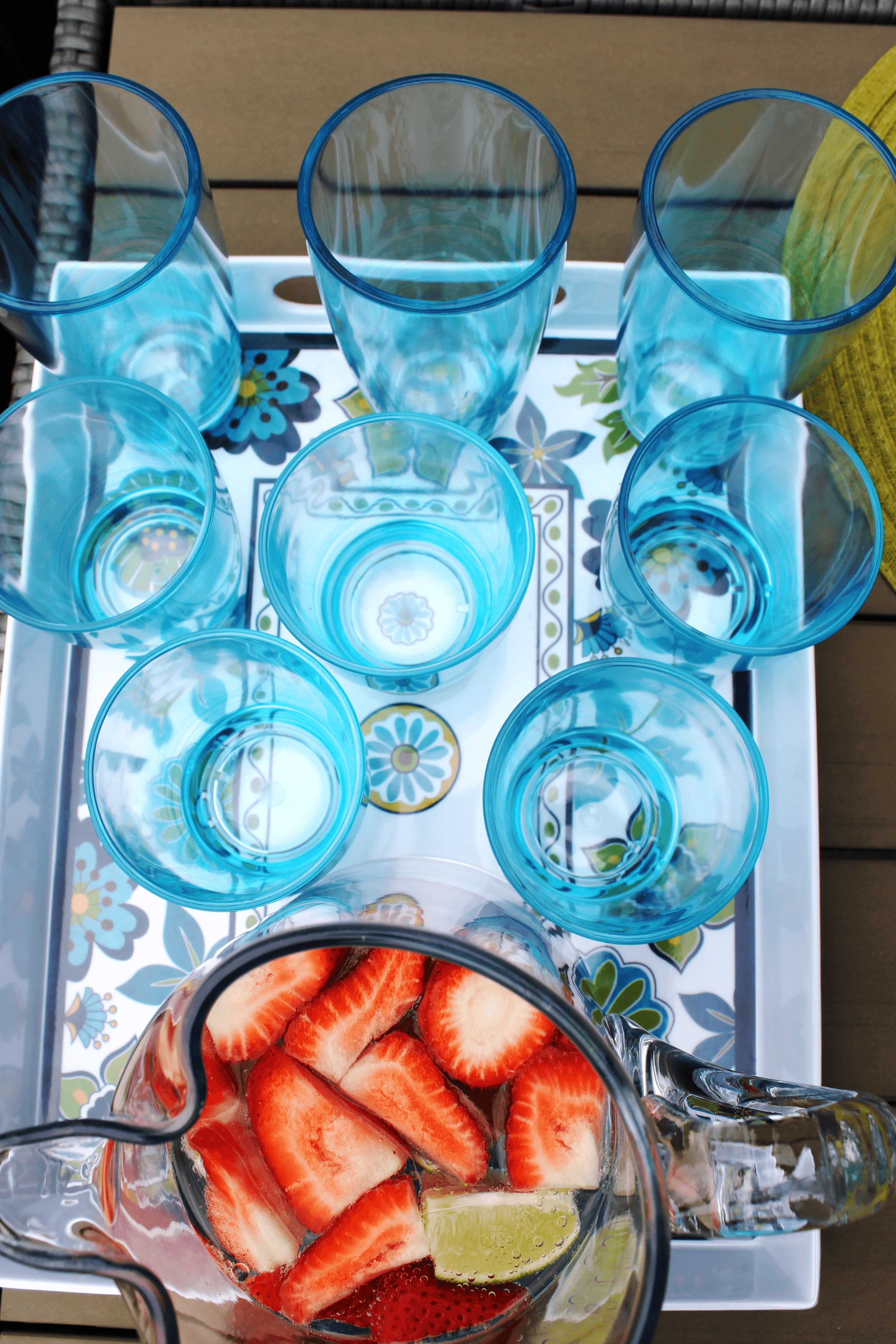 blue old fashioned glasses and highball glasses on a melamine tray