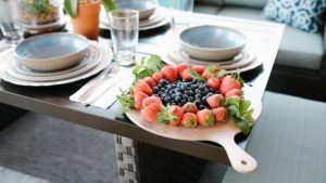 melamine cheese board with strawberries and blueberries