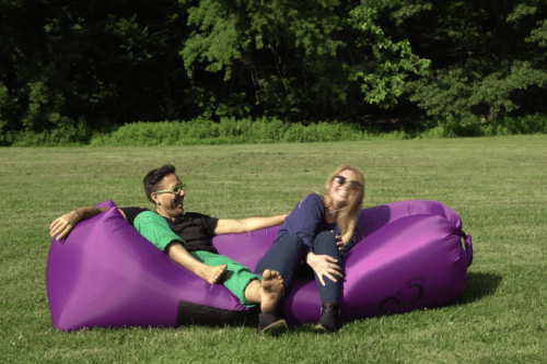 people smiling on inflatable chair