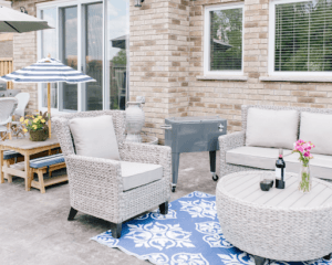 grey cooler chest beside patio furniture