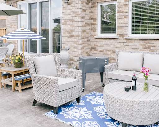 grey cooler chest beside outdoor patio furniture