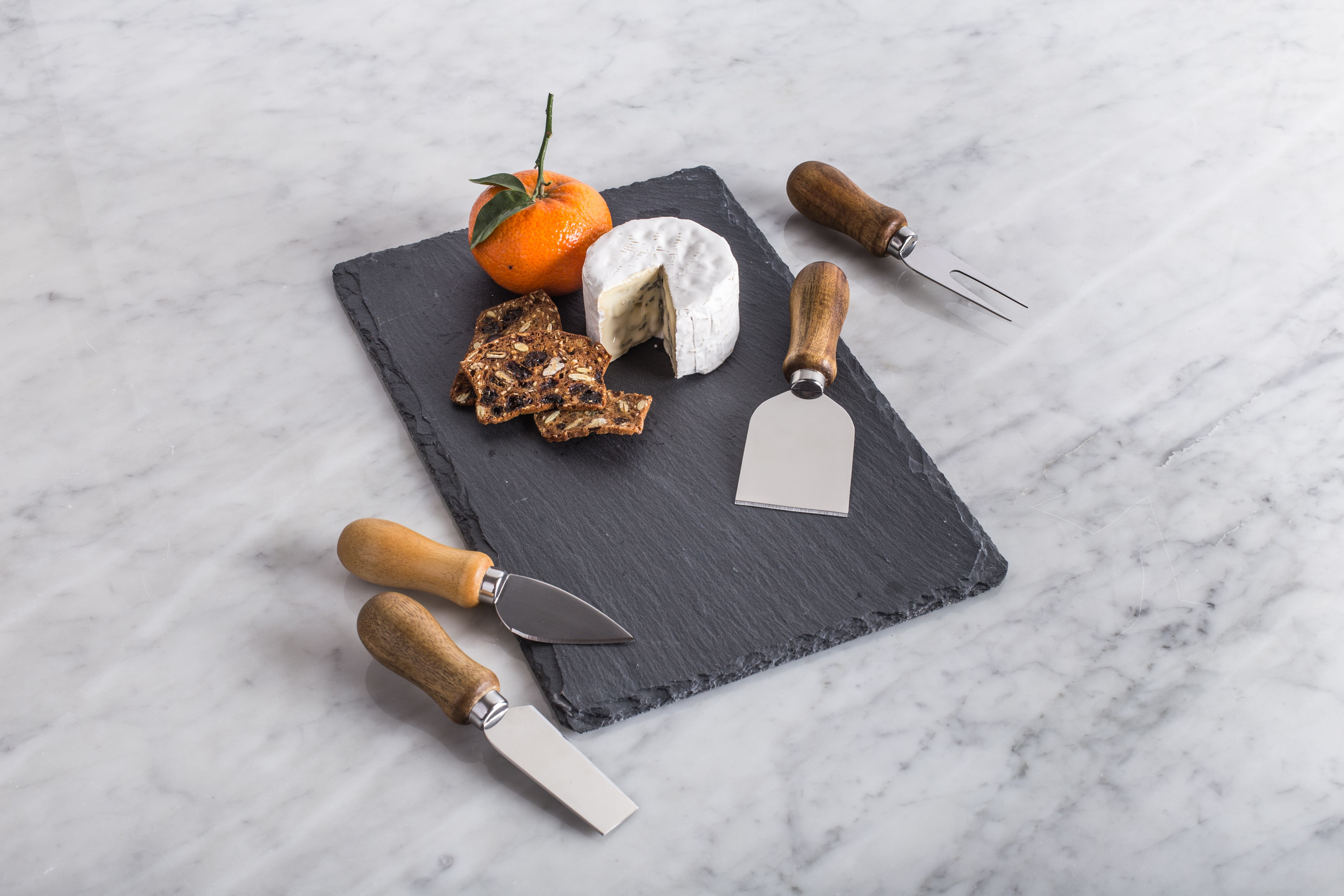 slate cheeseboard with 4 cheese tools with stainless steel blades and acacia wood handles and cheese and crackers