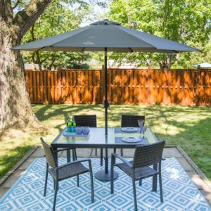 patio table with chairs and umbrella set