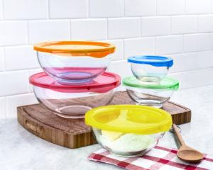 set of glass mixing bowls with colourful lids