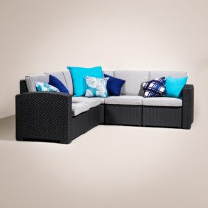 dark grey corner couch with cushions