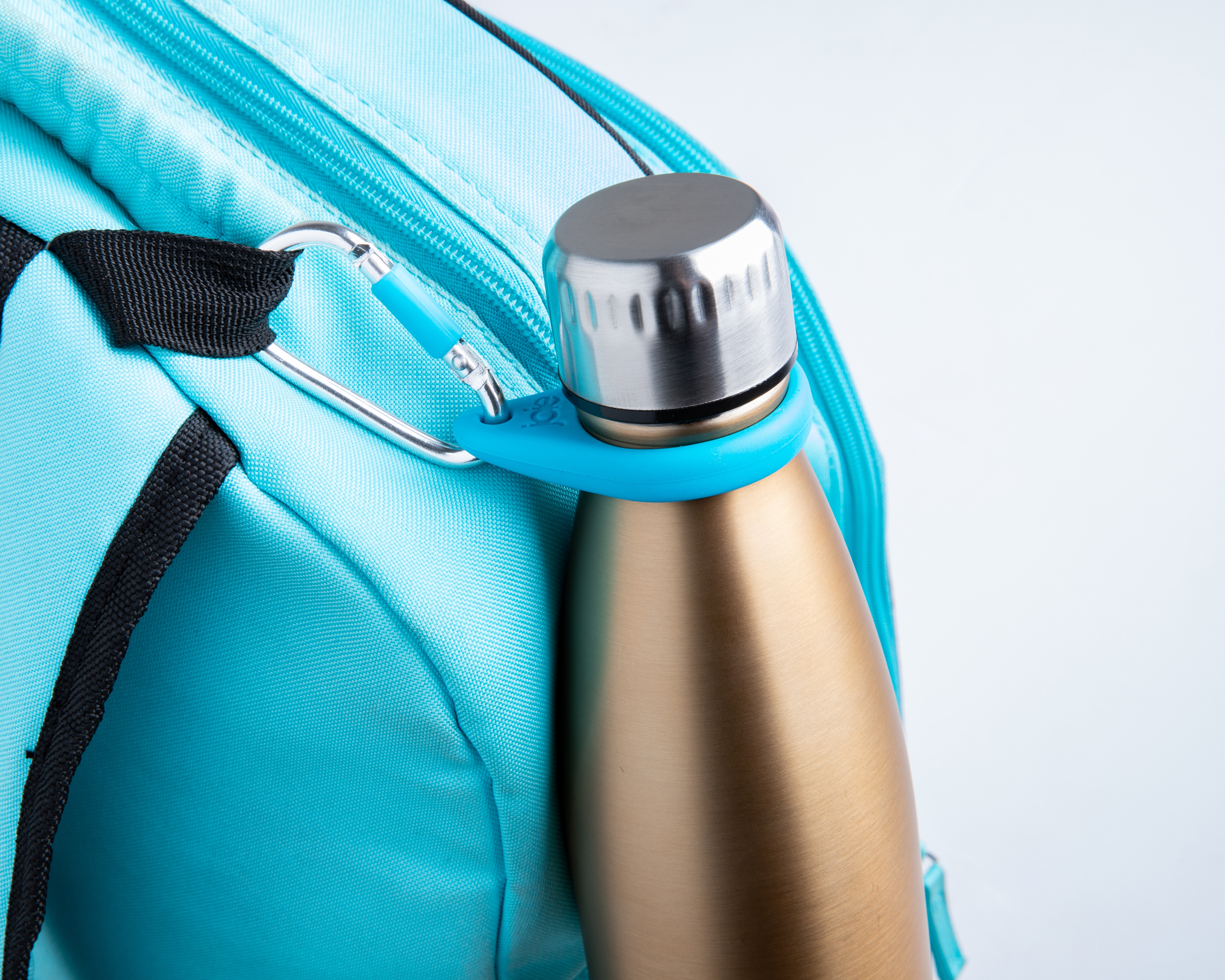 blue bottle carabiner attached to a backpack with a water bottle