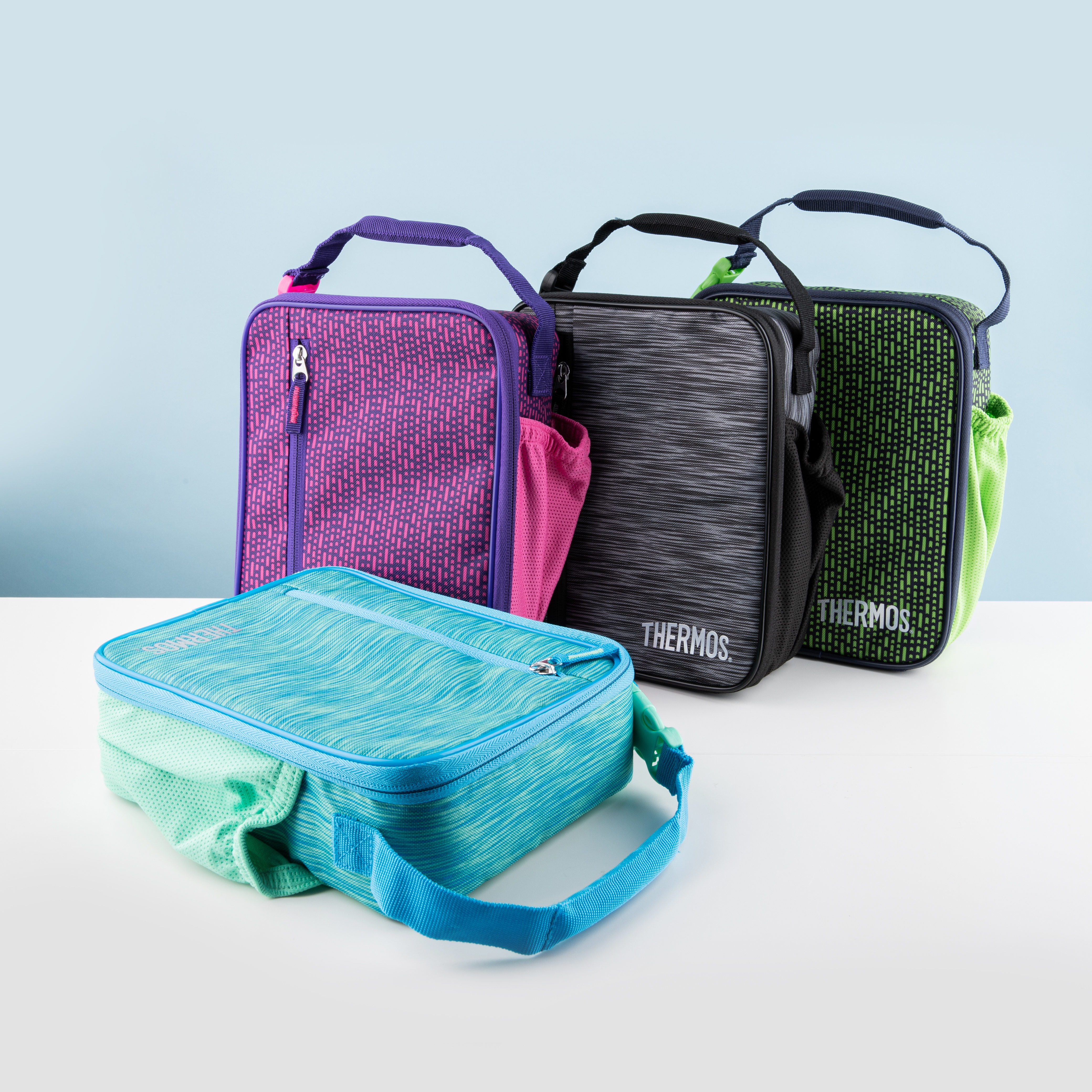3 lunch bags standing upright with one laying flat
