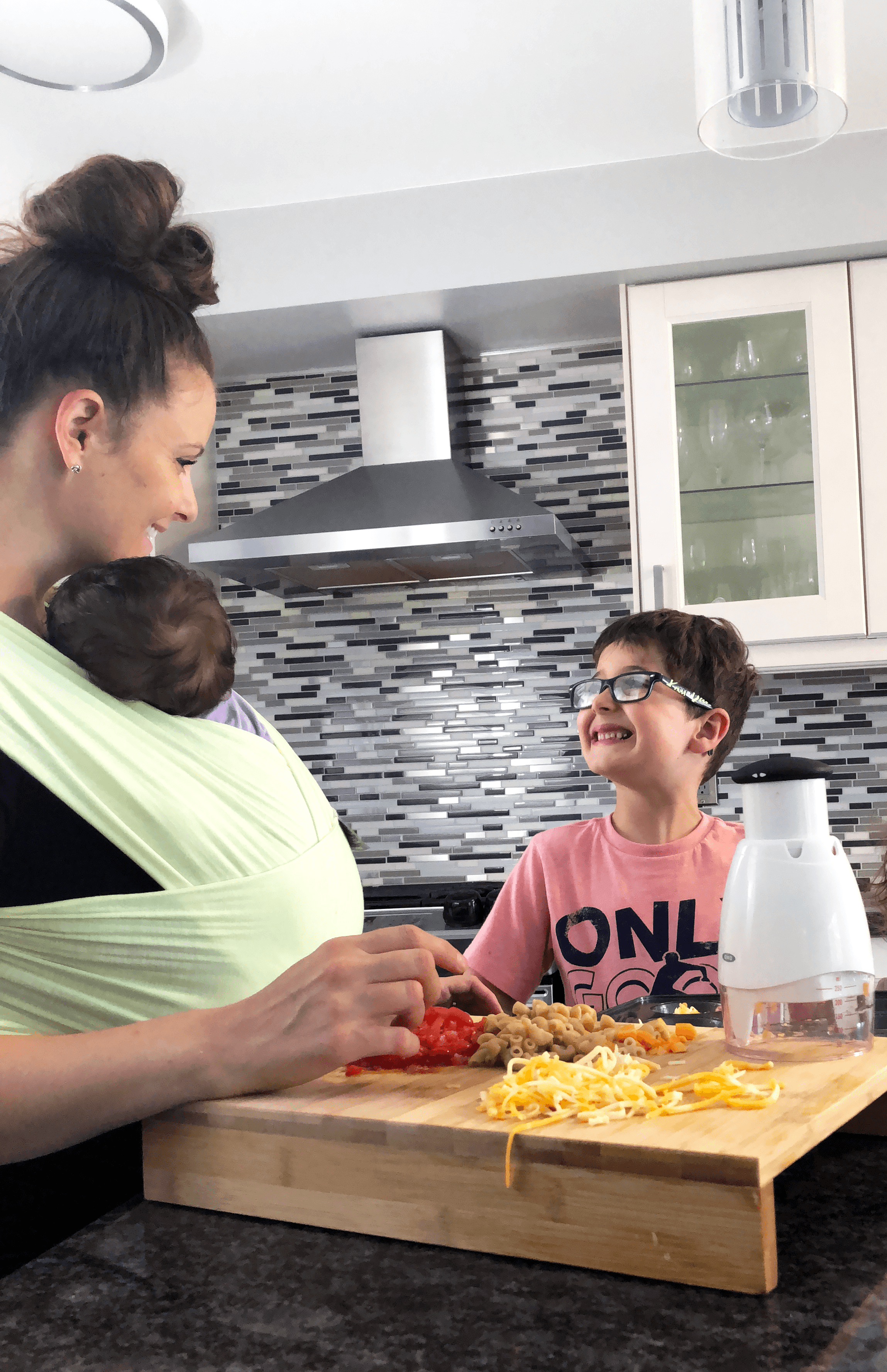 mom and child smiling at each other doing meal prep