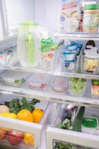 food prep organized in glass containers in a fridge